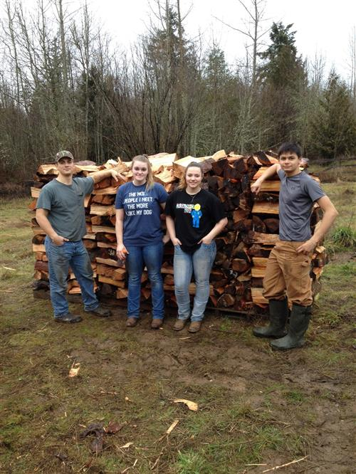 SKILLS USA Club donating firewood to the Rainier Education Foundation